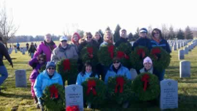 Headstones with wreaths at Saratoga National Cemetery