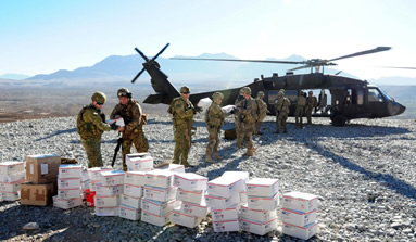 unloading boxes from helicopter